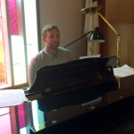Brother Aaron Pike playing the piano